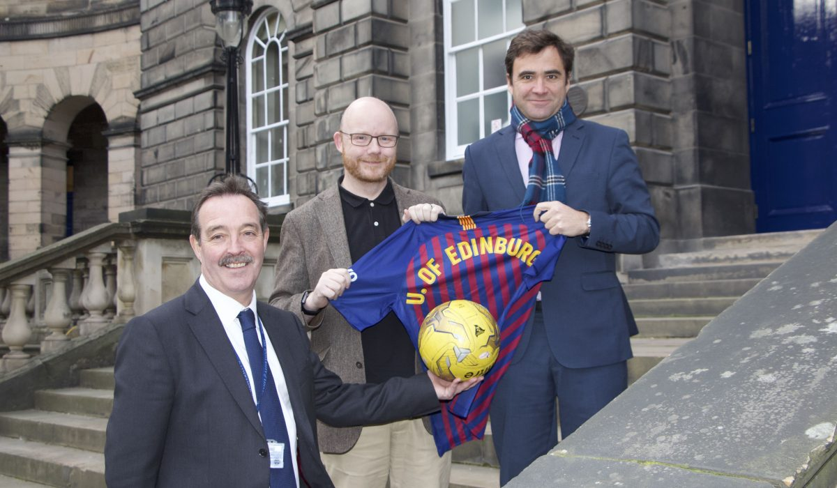 Professor Grant Jarvie and Professor James Smith with Javier Sobrino, FC Barcelona's Director of Strategy and Innovation holding an FC strip