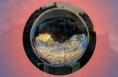 Edinburgh castle reflected upside down in a glass sphere