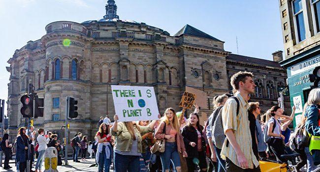 Climate change protesters walking through Edinburgh