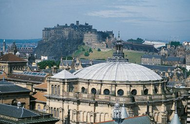 Aerial view of McEwan Hall with Edinburgh castle in the background